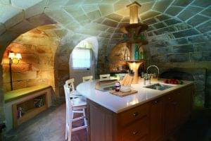 The modern kitchen is located in the atmospheric basement